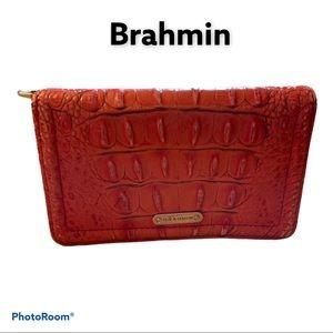 Brahmin wristlet missing strap. Orange croc.Flaws!